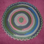 "Handbraided Round Wool Rug, 24""$25"