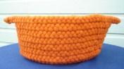 """Bright orange hand braided wool basket, 14"""" x 6-1/2"""" SOLD"""